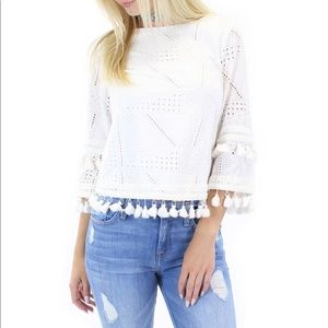 Eyelet blouse with tassels.